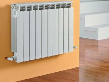 Радиаторы отопления в частном доме: практичность или красота